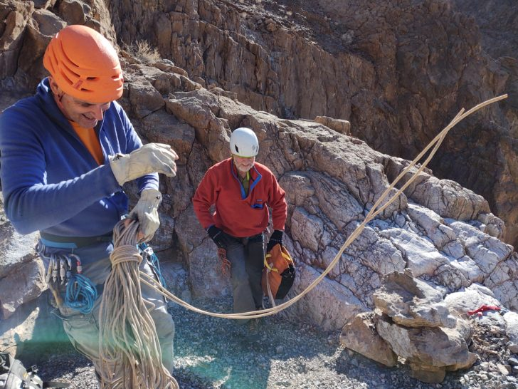 men dealing with canyoneering rope