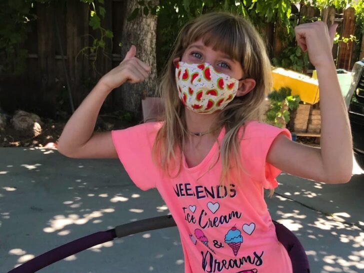 Girl wearing a cotton mask while hoola hooping