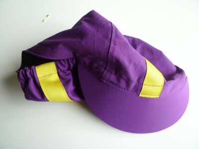 Purple cycling cap with yellow ribbon