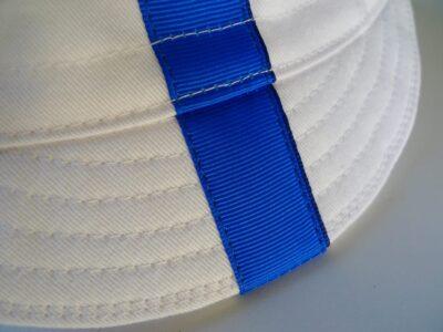 Blue ribbon on white cap
