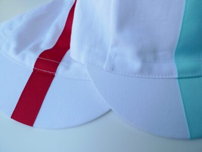 White cycling caps with grosgrain ribbon