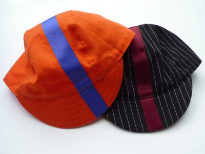 Two soft bill cycling caps with ribbon